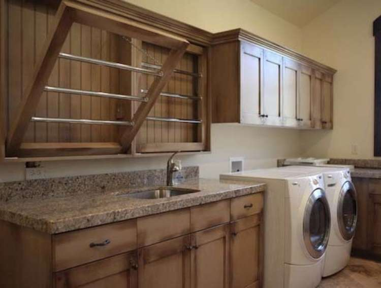 OneCrazyHouse DIY Home Organization laundry room with cabinets that open to reveal wooden brackets to hand wet lcothes to dry.