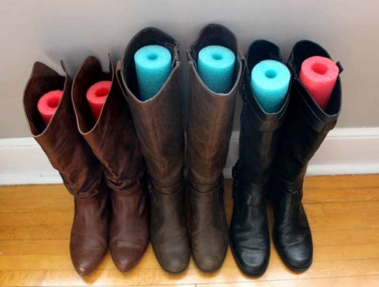 OneCrazyHouse DIY Home Organization leather boots with pieced of pool noodle cut to fit inside to prevent creases