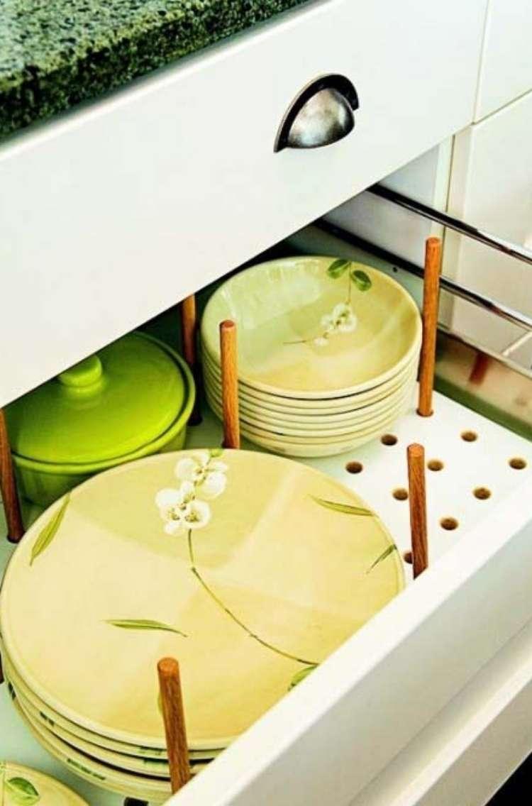 OneCrazyHouse DIY Home Organization open kitchen drawer revealing plates organized on top of peg board.