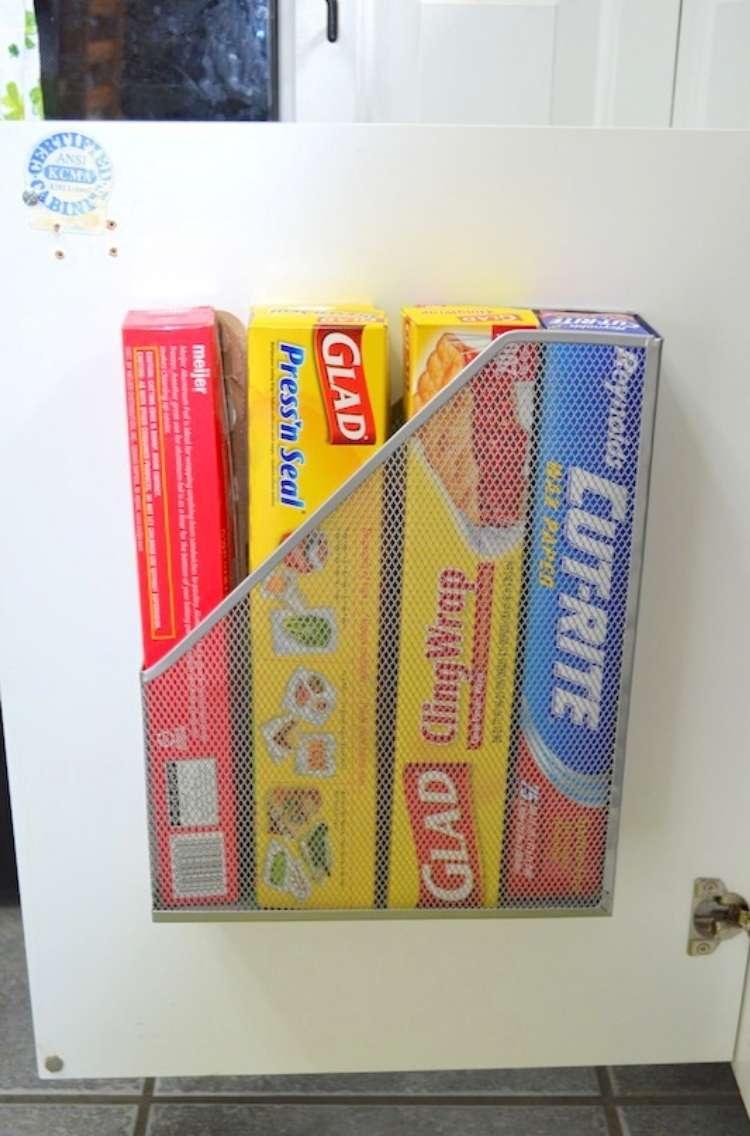 OneCrazyHouse DIY Home Organization magaznie holder attached to kitchen cabinet door with plastic wrap boxes neatly organized inside