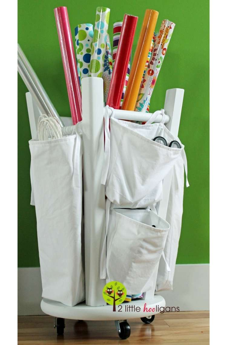 OneCrazyHouse DIY Home Organization giftwrap tubes being stored in upsidedown stool with storage area attached to the legs of the stool