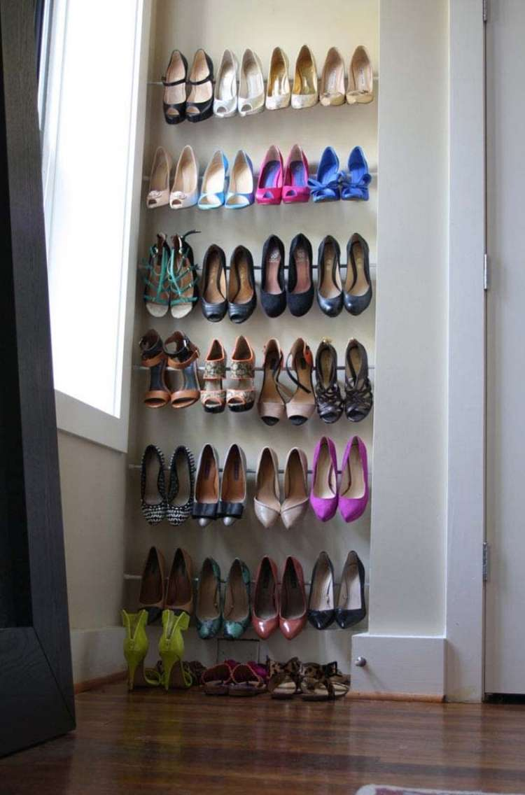 OneCrazyHouse DIY Home Organization tension rods holding a display of shoes