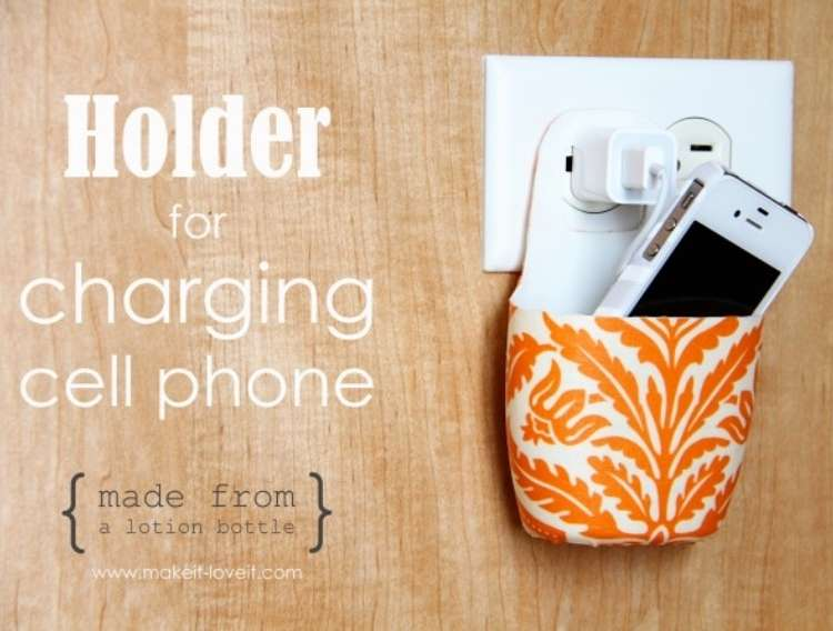 OneCrazyHouse Dorm Room Decor charging cell phone inside of a holder attached to plug on wall