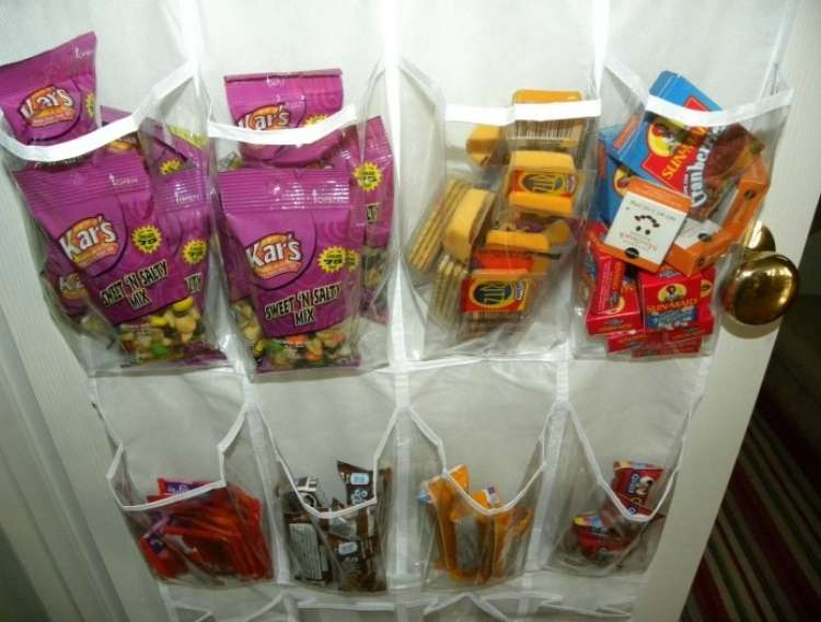 OneCrazyHouse Dorm Room Decor shoe organizer filled with snacks in each compartment
