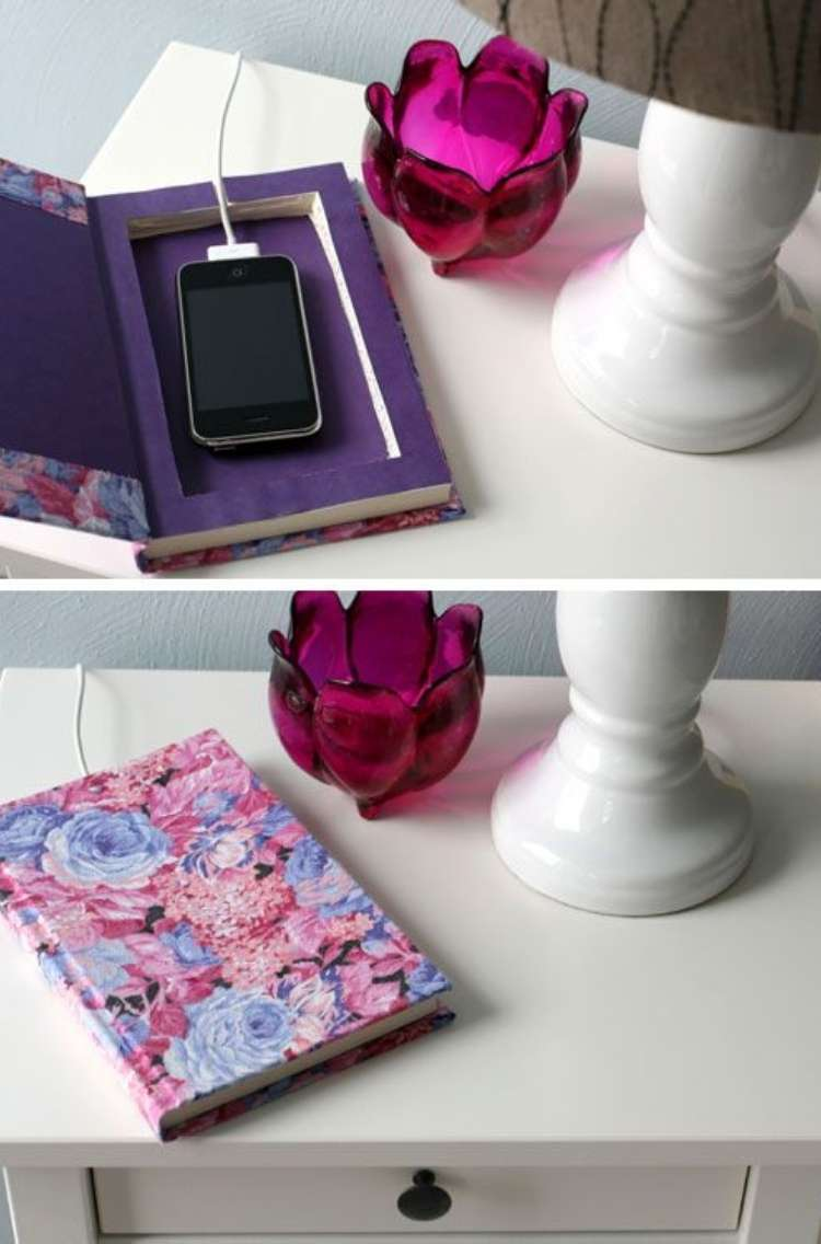 OneCrazyHouse Dorm Room Decor open book revealing compartment for charging phone, bottom shot of closed book with charger cable coming out of the back