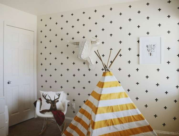 OneCrazyHouse Dorm Room Decor wall decorated with washi tape crosses with clother Teepee and seat in the room in fron't of the wall