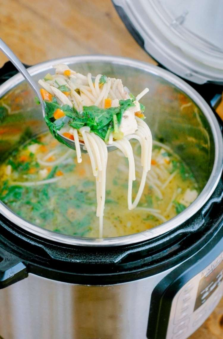 One Crazy House Instant Pot Dinners Ladle of chicken noodle soup brought out of instant pot