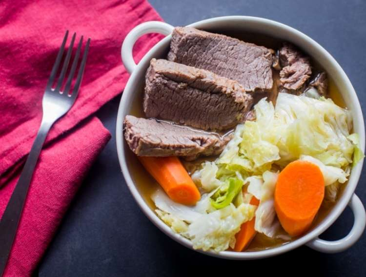 One Crazy House Instant Pot Dinners Corned beef and cabbage in a pot with a fork and napkin next to it