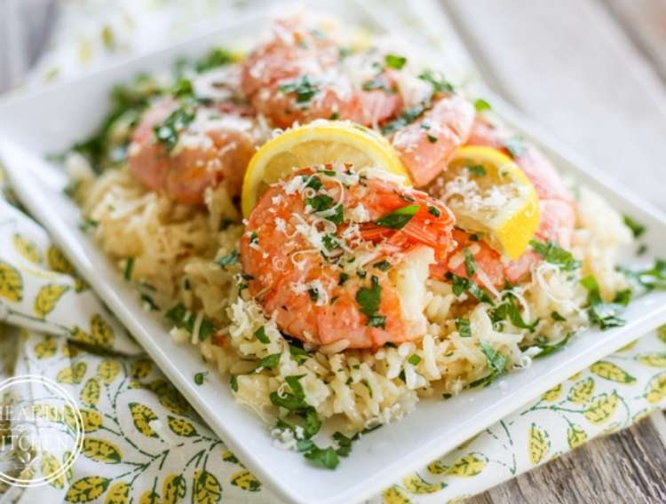 One Crazy House Instant Pot Dinners plate of rice covered in garnished scampi shrimp