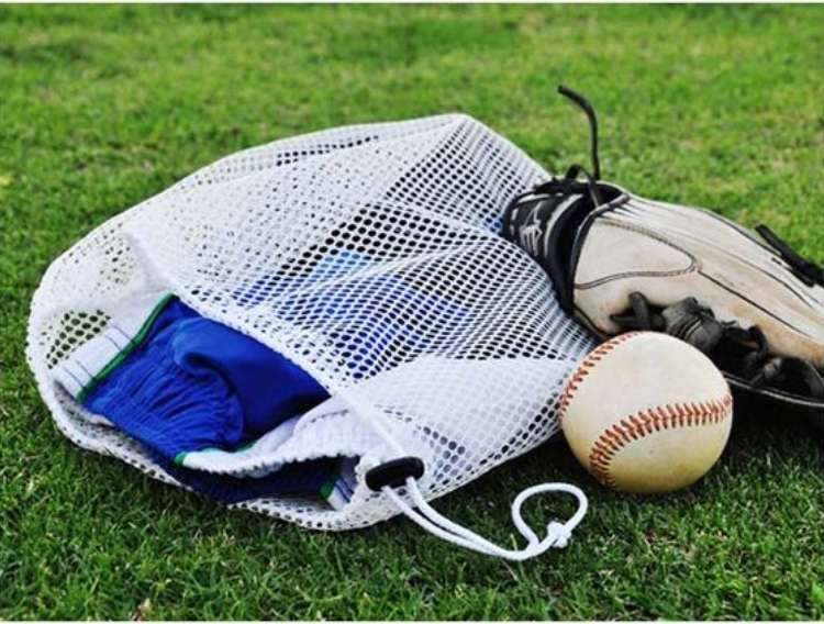 OneCrazyHouse Mesh Laundry Bags mesh laundry bag on grass filled with sports equiptments with a baseball and a glove laying beside the bag