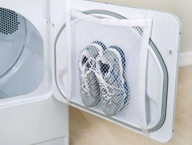 OneCrazyHouse Mesh Laundry Bags mesh bag repurposed as a net to hold sneakers on dryer door
