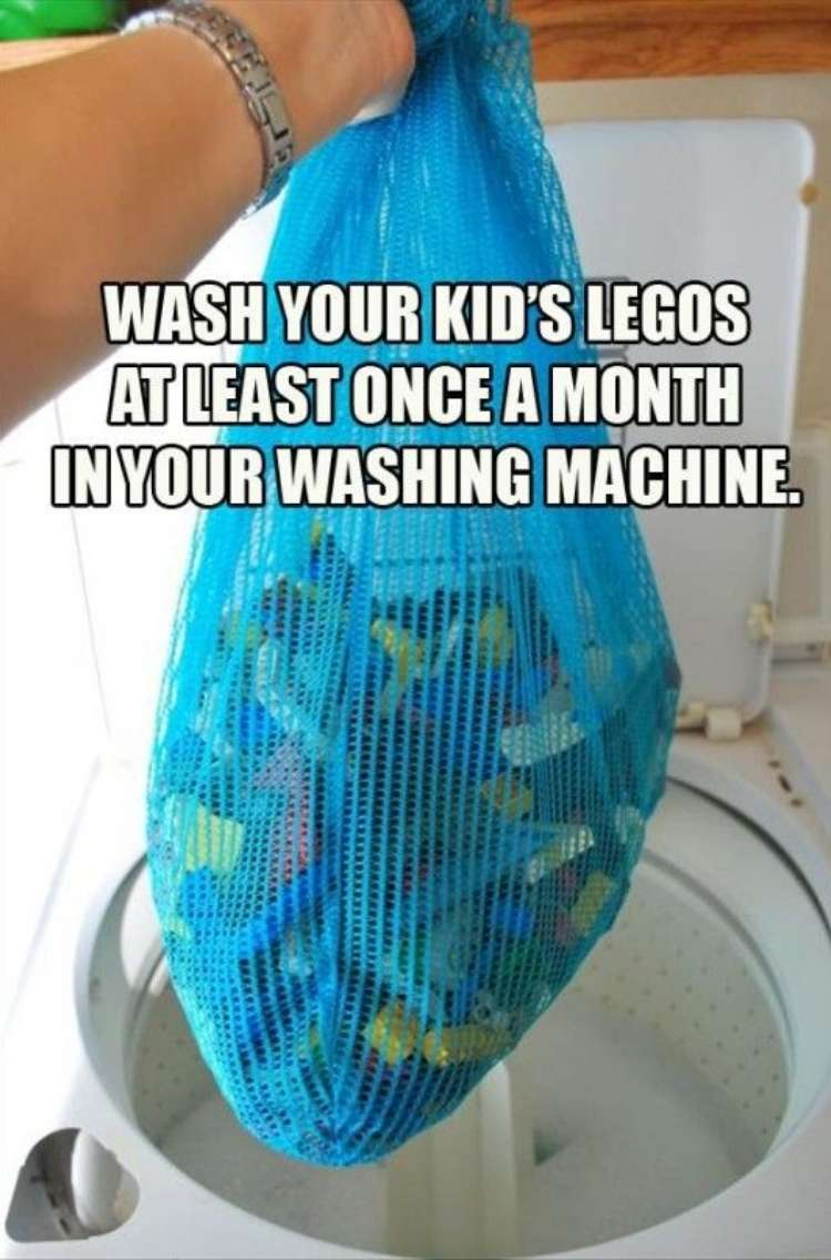 """OneCrazyHouse Mesh Laundry Bags mesh bag filled with Lego Toys being held over a washer with the words """"Wash you kids legos in the washing machine at least once a month"""""""