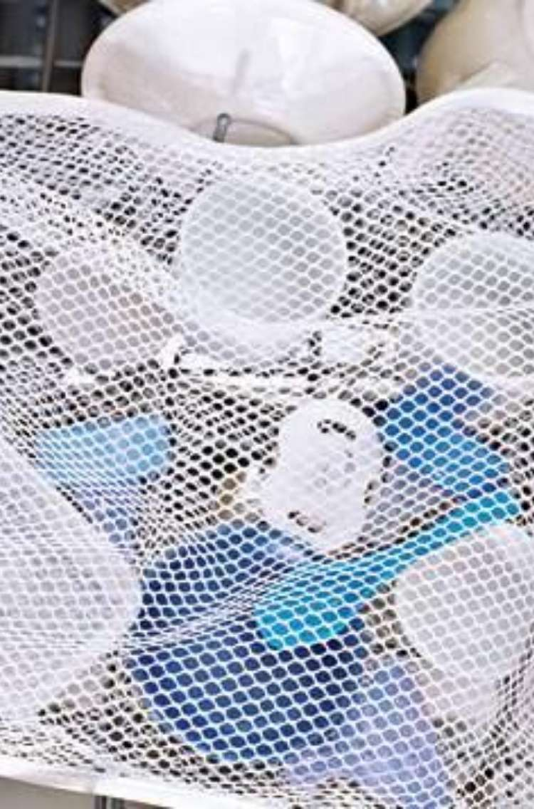 OneCrazyHouse Mesh Laundry Bags Zippered mesh bad inside of a dishwasher with small artciles like measuring cups and baby binkies