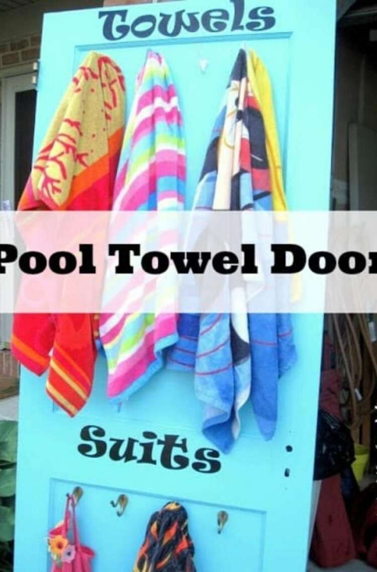 OneCrazyHouse pool storage towels hung from hooks on a door deignated as the towel door