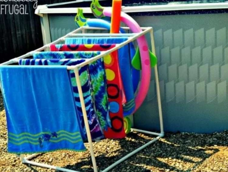 OneCrazyHouse pool storage PVC pipes built into a clothes dryer for pool towels and toys