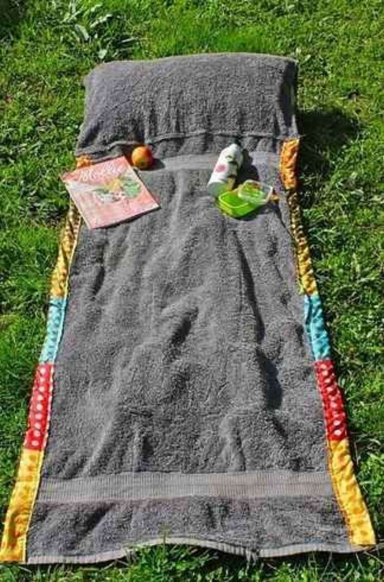 OneCrazyHouse pool storage DTT beach towel bag layed out as a towel on grass