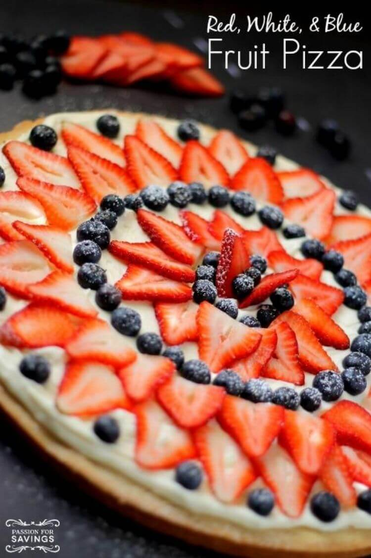 Fruit pizza with sliced strawberries and blueberries on top - 4th of July food idea