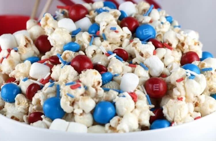 Popcorn with red, white, and blue M&Ms and sprinkles - a 4th of July food idea