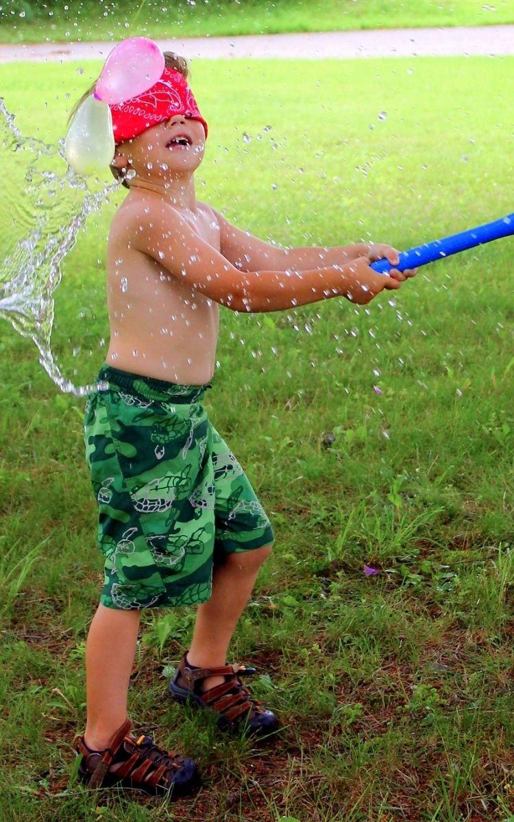 Water balloon piñata game