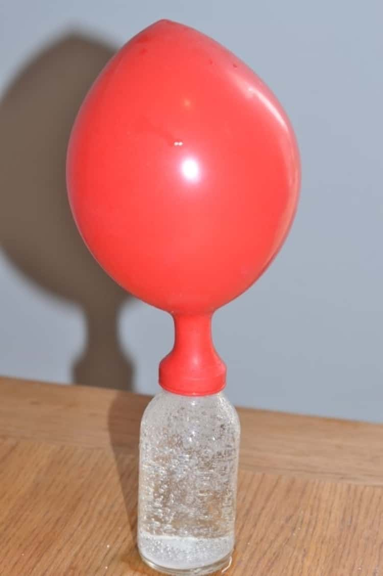 A photo illustrating how to blow up a balloon using water and alka-seltzer