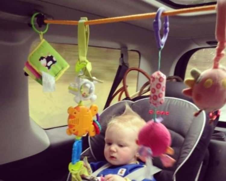 toddler activity center made using a bungee cord