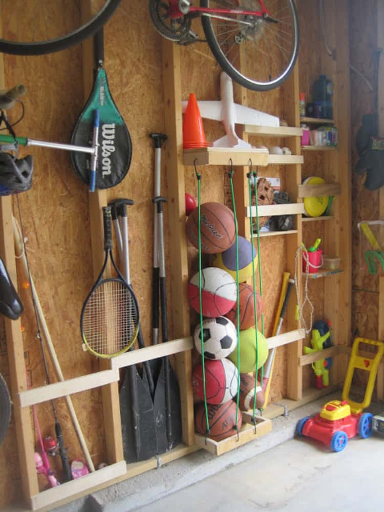 balls organized with bungee cords between studs and a ball organizer