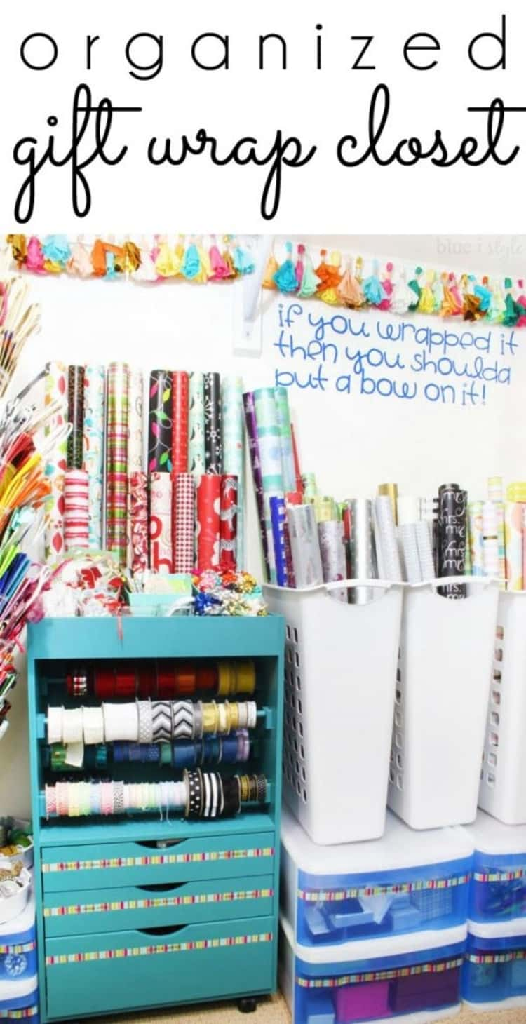 organized gift wrap closet with wrapping paper, drawers, bins, ribbons, and gift bags