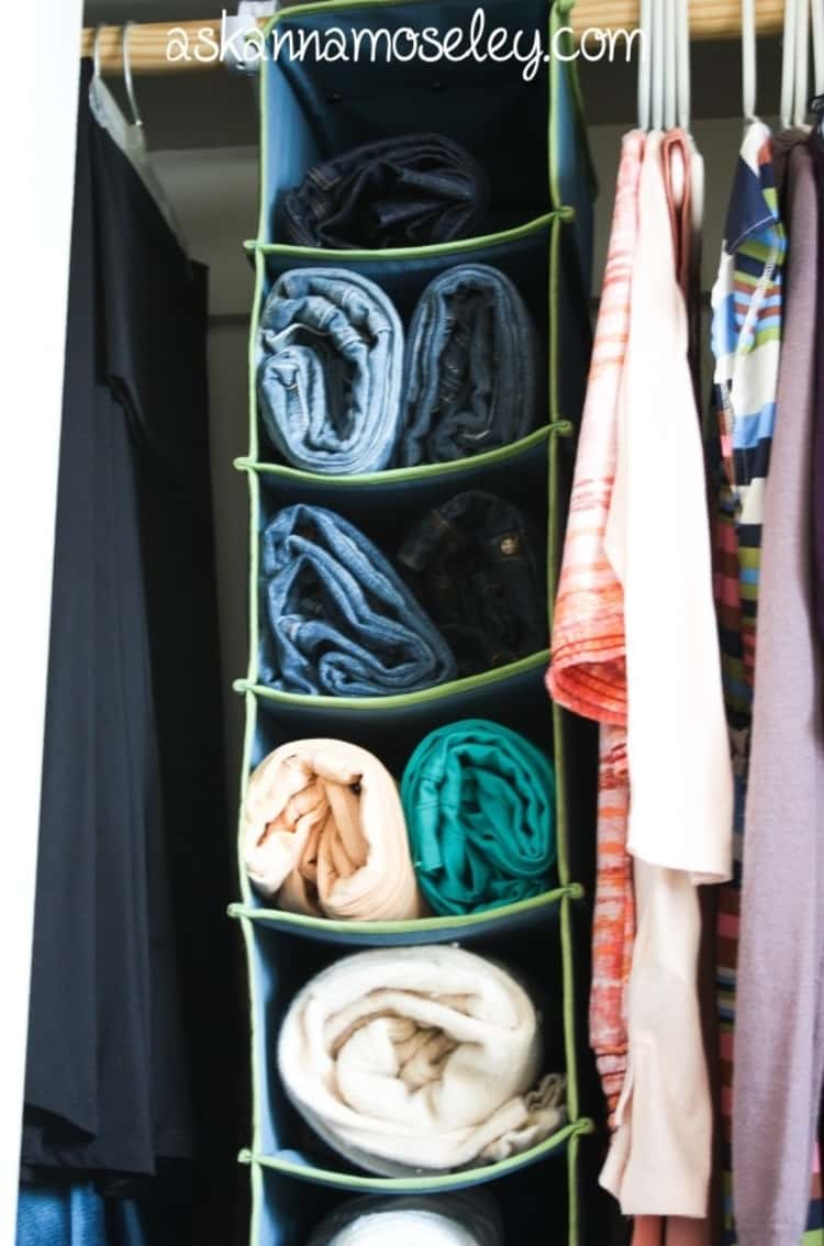 store sweaters and jeans in a shoe cubby to save space