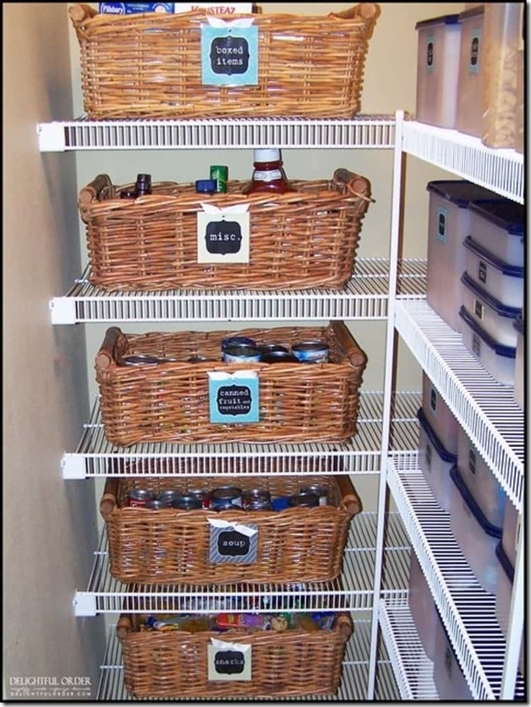 wicker baskets on pantry shelves with labels on the front and food stored inside