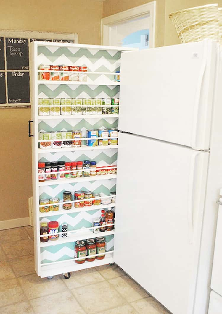 canned food organizer slide out next to a white fridge