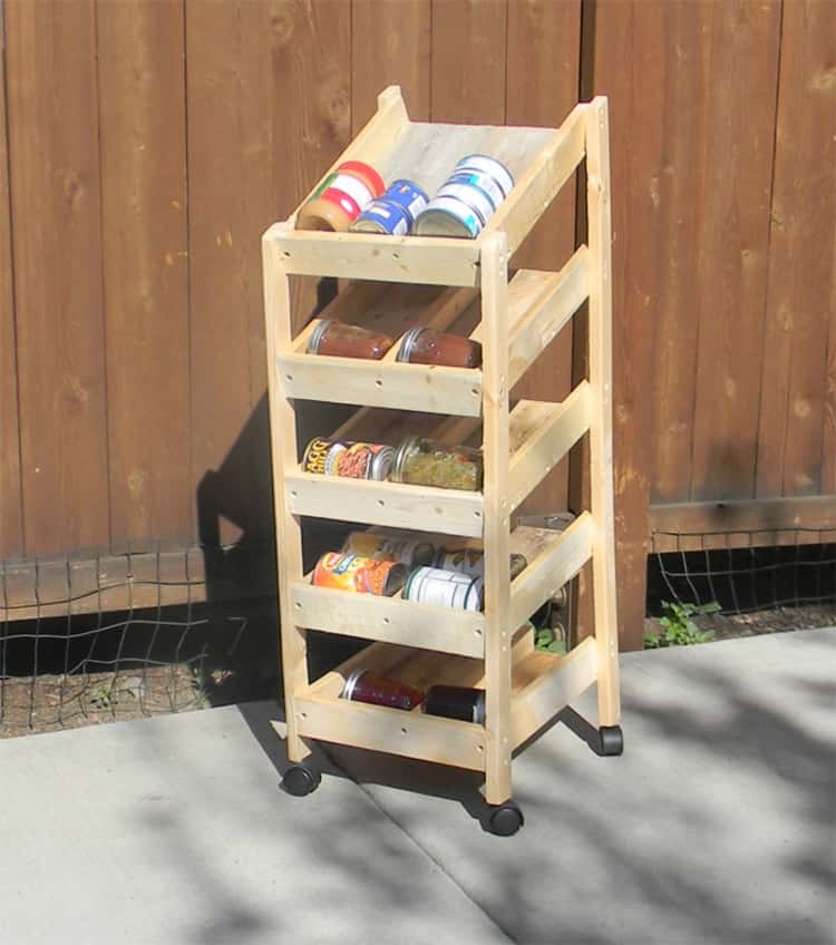 diy rotating wood canned food rack with canned goods inside sitting on driveway