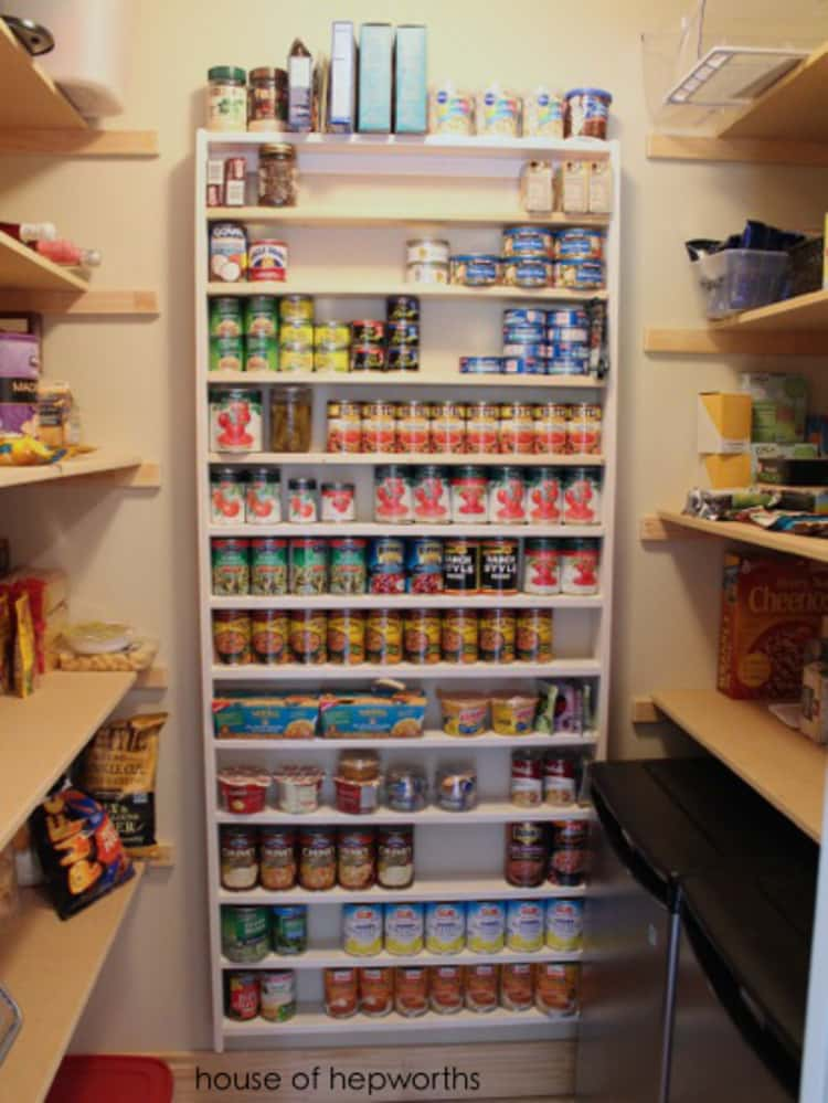 canned food storage wall on the back wall of the pantry with canned goods on it