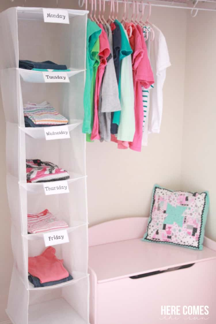 children's clothing stored and sorted in hanging shoe cubby with weekday labels