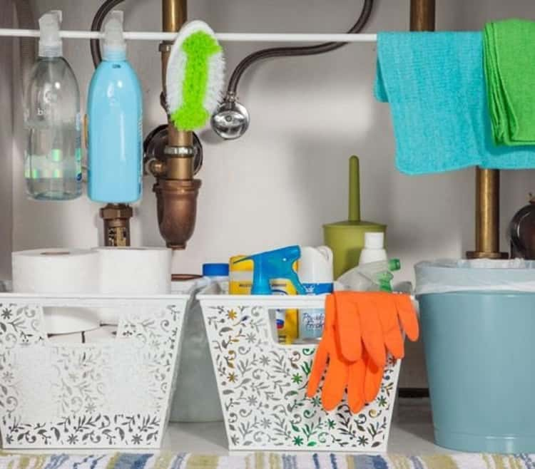 Use plastic bins to organize together like-cleaning supplies