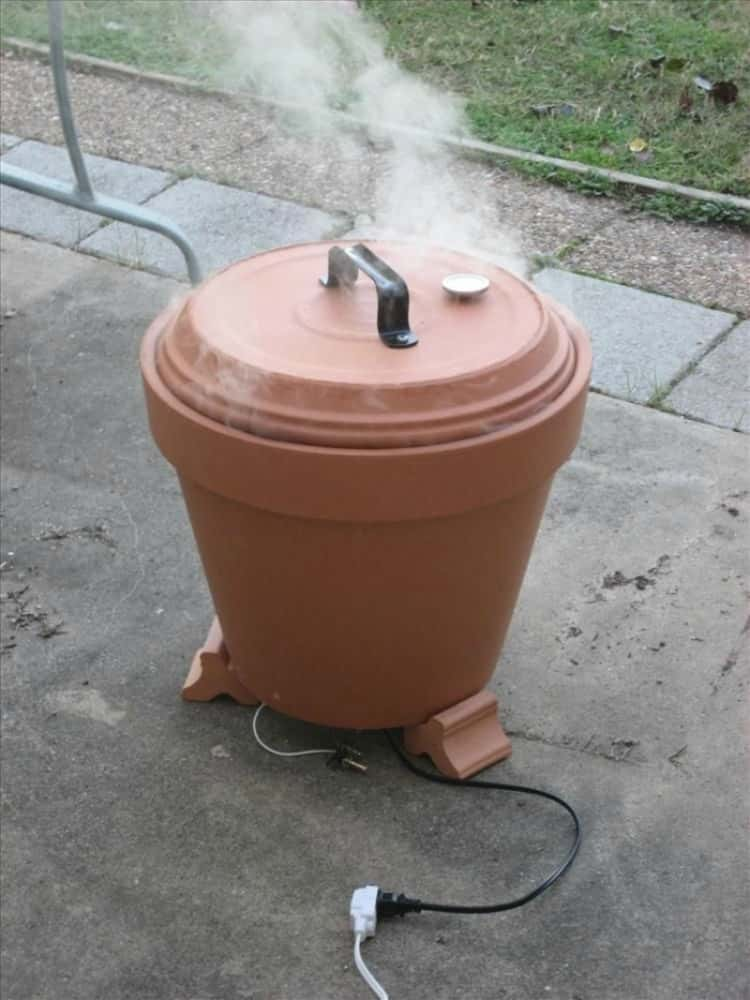 An outdoor smoker made with a clay pot and some DIY skills
