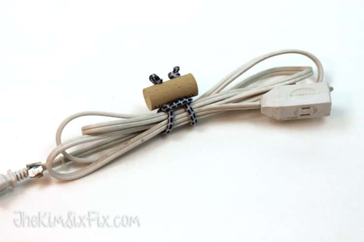 extension cable tied up using a cord tie made from a bungee cord