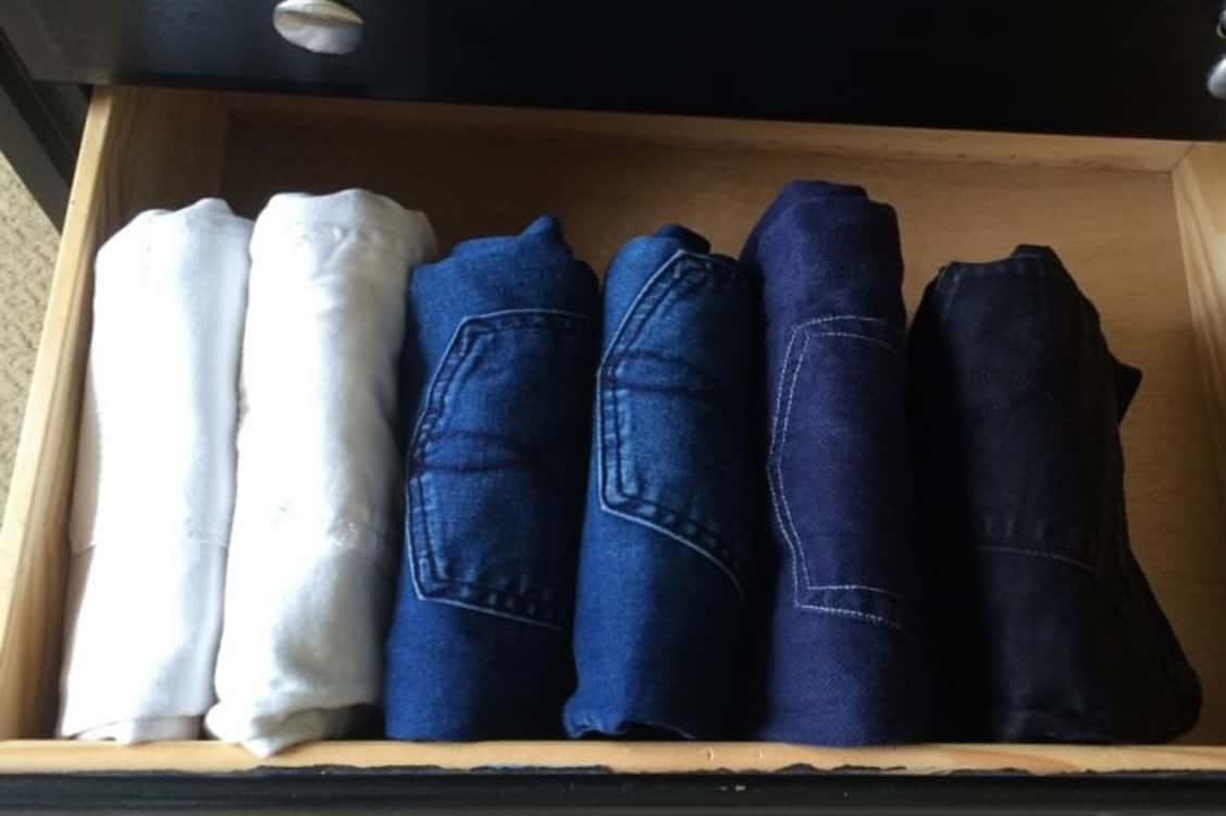 folded jeans filed away in drawer