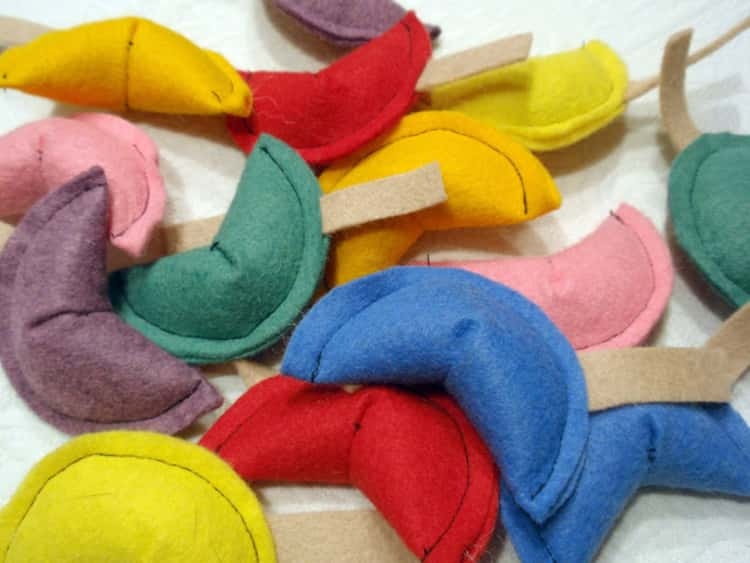 assorted fortune cookie cat toys made from felt fabric