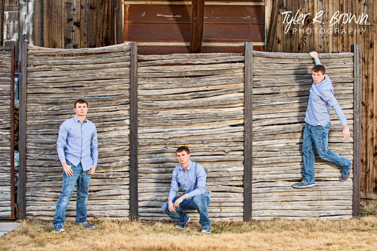 senior picture ideas for guys - image with 3 different poses of a guy posing in front of a rustic fence