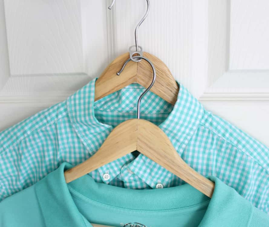 to store more clothes in less space, use a soda can tab to connect two hangers together