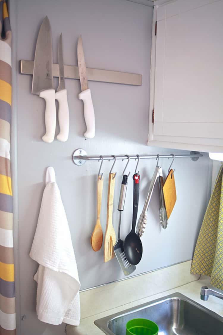 hanging utensils on shower hooks next to sink