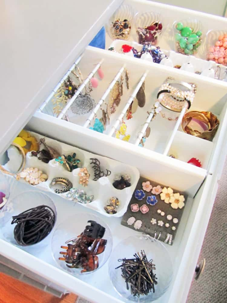 Egg carton in use as a jewelry organizer
