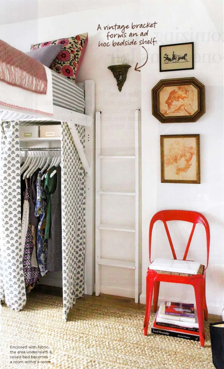 loft bed with makeshift closet underneath for extra clothes storage