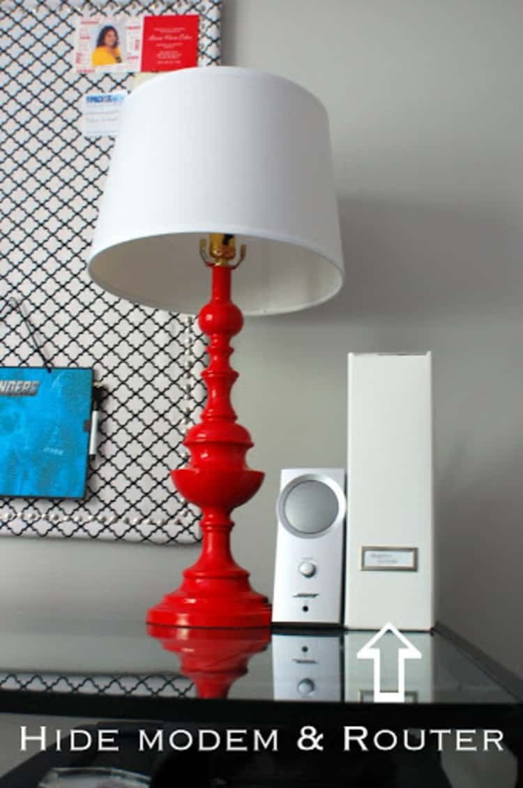 White magazine holder where you can hide your home's modem and router