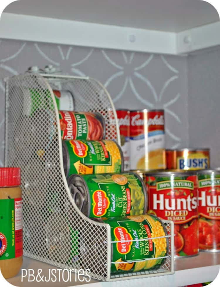 Food pantry showing a DIY mini food dispenser using a meshed magazine holder