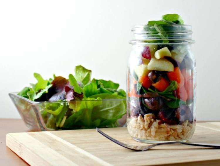 Salad in a square bowl and in a glass