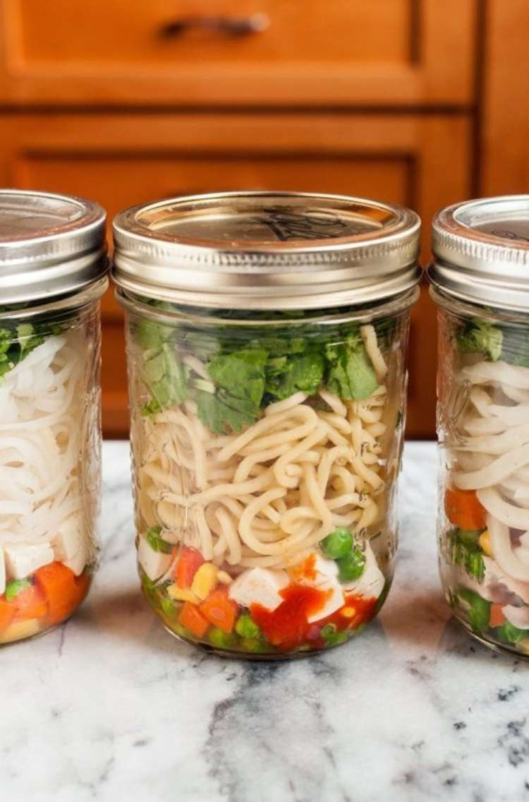 Ramen: three jars filled with noodles, colorful veggies, and other toppings