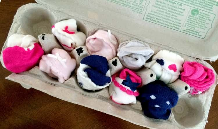 Egg carton in use as a paired socks organizer