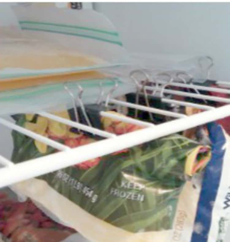 Organize Your fridge by hanging bags of food using clips