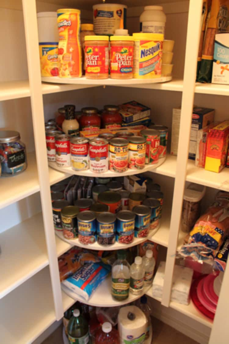 diy lazy susan in the corner of the pantry holding canned goods